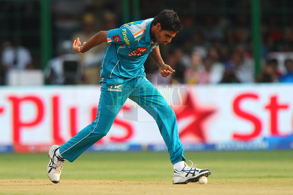Bhuvneshwar Kumar stops the ball with his shoe during match 31 of the Pepsi Indian Premier League between The Royal Challengers Bangalore and The Pune Warriors India held at the M. Chinnaswamy Stadium, Bengaluru  on the 23rd April 2013..Photo by Ron Gaunt-IPL-SPORTZPICS ..Use of this image is subject to the terms and conditions as outlined by the BCCI. These terms can be found by following this link:..http://www.sportzpics.co.za/image/I0000SoRagM2cIEc
