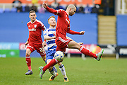Reading FC defender Paul McShane tackled by Cardiff City midfielder Anthony Pilkington during the Sky Bet Championship match between Reading and Cardiff City at the Madejski Stadium, Reading, England on 19 March 2016. Photo by Mark Davies.