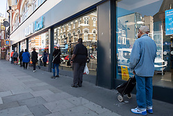 © Licensed to London News Pictures. 29/05/2020. London, UK. People observe social distancing queuing upo outside Aldi supermarket in KIlburn. The government has announced a relaxing of lockdown rules from  next Monday. Photo credit: London News Pictures