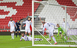 LIVERPOOL, ENGLAND - Tuesday, December 9, 2014: FC Basel's Antonio Fischer clears the ball from behind the line, but no goal was awarded, during the UEFA Youth League Group B match against Liverpool at Langtree Park. (Pic by David Rawcliffe/Propaganda)