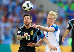 MOSCOW, RUSSIA - Saturday, June 16, 2018: Argentina's Lionel Messi (left) and Iceland's Hordur Magnusson (right) during the FIFA World Cup Russia 2018 Group D match between Argentina and Iceland at the Spartak Stadium. (Pic by David Rawcliffe/Propaganda)