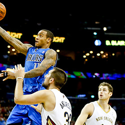 Dec 4, 2013; New Orleans, LA, USA; Dallas Mavericks shooting guard Monta Ellis (11) shoots over New Orleans Pelicans power forward Ryan Anderson (33) during the second quarter of a game at New Orleans Arena. Mandatory Credit: Derick E. Hingle-USA TODAY Sports