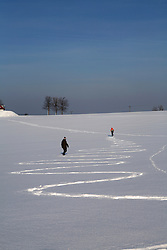 CZECH REPUBLIC VYSOCINA NEDVEZI 27JAN12 - Two hikers leave a path in the snowy winter landscape near the village Nedvezi, Vysocina, Czech Republic.....jre/Photo by Jiri Rezac....© Jiri Rezac 2012