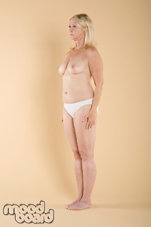 Full length of a woman standing topless