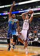 Apr 7, 2013; Phoenix, AZ, USA; Phoenix Suns guard Goran Dragic (1) looks to make a pass against the New Orleans Hornets guard Eric Gordon (10) in the first half at US Airways Center. Mandatory Credit: Jennifer Stewart-USA TODAY Sports