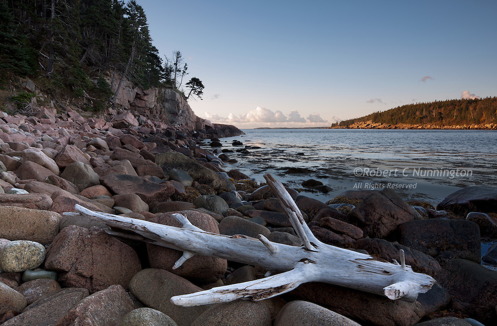 The pebble beaches of Acadia National Park are a popular location for photographers and tourists alike.