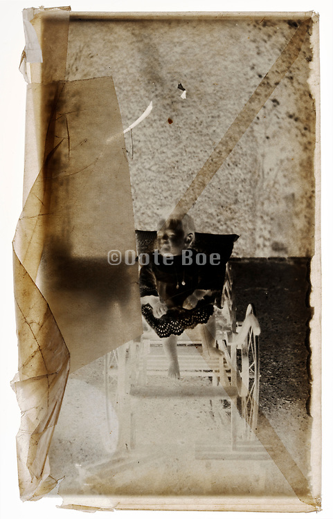 glass plate negative with toddler portrait in semi transparent protective envelope