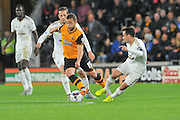 Shaun Maloney  and Leon Britton  fight for the ball during the Capital One Cup match between Hull City and Swansea City at the KC Stadium, Kingston upon Hull, England on 22 September 2015. Photo by Ian Lyall.