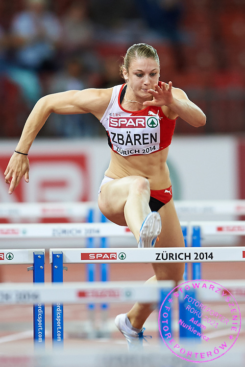 Noemi Zbaren from Switzerland competes in women's 100 meters hurdles Semi-Final during the First Day of the European Athletics Championships Zurich 2014 at Letzigrund Stadium in Zurich, Switzerland.<br /> <br /> Switzerland, Zurich, August 12, 2014<br /> <br /> Picture also available in RAW (NEF) or TIFF format on special request.<br /> <br /> For editorial use only. Any commercial or promotional use requires permission.<br /> <br /> Photo by &copy; Adam Nurkiewicz / Mediasport