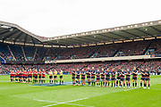 Both teams observe a minutes applause before the Heineken Champions Cup quarter-final match between Edinburgh Rugby and Munster Rugby at BT Murrayfield Stadium, Edinburgh, Scotland on 30 March 2019.