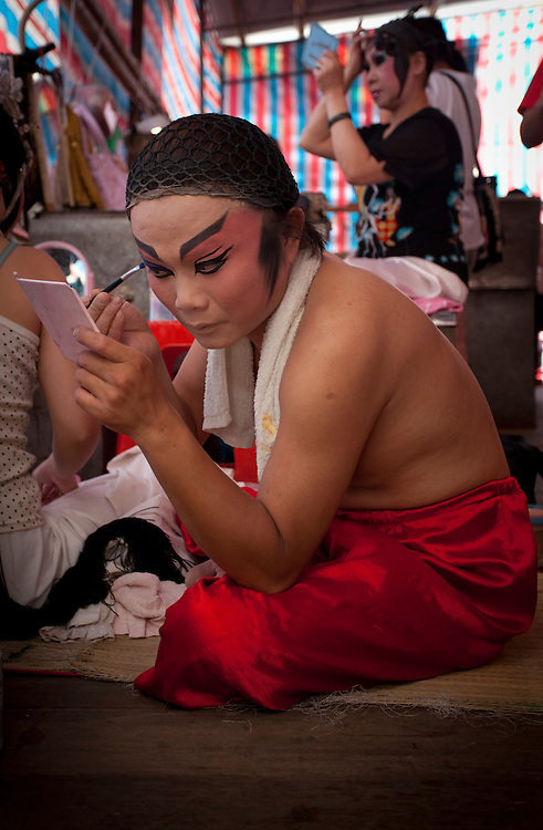 Backstage at an opera performance. Originating in eastern Taiwan in the late 19th century, Taiwanese folk opera is part of the southern variations of Chinese opera. As the only form of Han traditional drama to have come from Taiwan, it was started by immigrants from Fujian, China and told folk stories of the region. While its popularity has declined in the modern era, it still plays an important role in Taiwanese culture.