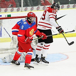 COBOURG, - Dec 19, 2015 -  Gold Metal Game - Russia vs Canada West at the 2015 World Junior A Challenge at the Cobourg Community Centre, ON. Tyler Maltby #19 of Team Canada West gets hit in the leg with the puck during the third period.(Photo: Tim Bates / OJHL Images)