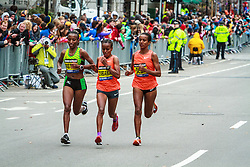 Boston Marathon: top three female runners with less than a mile to go, Caroline Rotich, Mare Dibaba, Buzunesh Deba