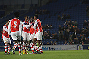 The Arsenal Players celebrate during the Barclays U21 Premier League match between Brighton U21 and Arsenal U21 at the American Express Community Stadium, Brighton and Hove, England on 1 December 2014.