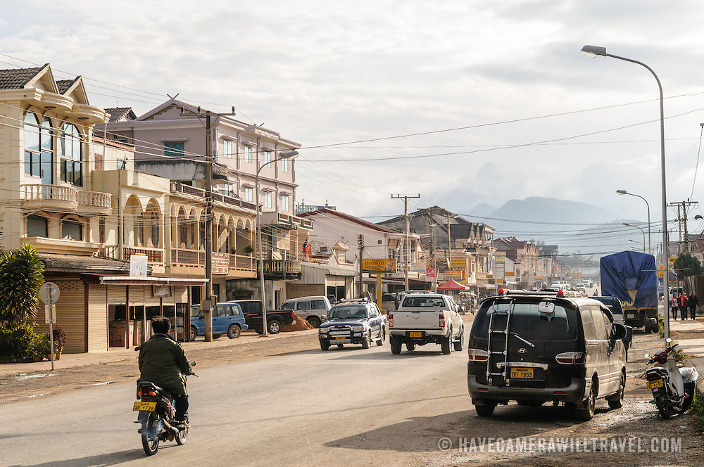 The dusty main street in Phonsavan in northeastern Laos, capital of Xieng Khouang Province and a central town in the Plain of Jars. The people of the region are predominantly of Hmong ethnicity.