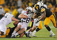 October 20 2012: Penn State Nittany Lions running back Zach Zwinak (28) is brought down by Iowa Hawkeyes defensive lineman Joe Gaglione (99) during the first half of the NCAA football game between the Penn State Nittany Lions and the Iowa Hawkeyes at Kinnick Stadium in Iowa City, Iowa on Saturday October 20, 2012. Penn State defeated Iowa 38-14.