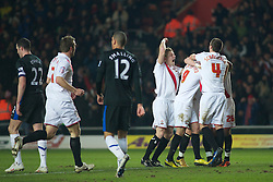 SOUTHAMPTON, ENGLAND - Saturday, January 29, 2011: Southampton players surround Richard Chaplow (C) after he scores the opening goal to make it 1-0 during the FA Cup 4th Round match at St. Mary's Stadium. (Photo by Gareth Davies/Propaganda)