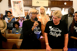Dorothy Johnson-Speight, founder of Mothers in Charge raises a question about gun violence to Mayor Jim Kenney, during a Mayoral Candidate forum at Janes Church in Germantown on Sunday. (Bastiaan Slabbers for WHYY)