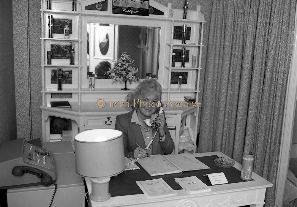 Bronwyn Conroy Beauty School.   (N60)..1981..06.02.1981..02.06.1981..6th February 1981..The Bronwyn Conroy Beauty School ,established in 1971,currently has its premises at 40 Grafton Street ,Dublin.Bronwyn Conroy is renowned in the beauty business in Ireland. She runs full and part time courses for students in all aspects of beauty and massage etc. Students, when they qualify,attain educational certificates which are recognised throughout the beauty world..Portrait of Ms Bronwyn Conroy at her desk in the beauty school in Grafton Street,Dublin.