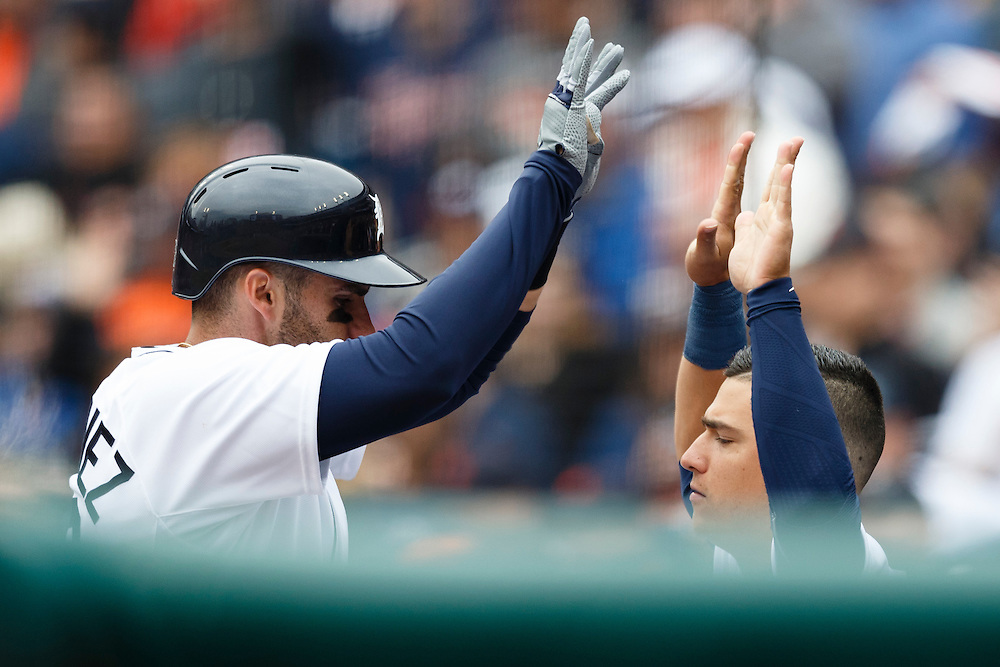 Apr 6, 2015; Detroit, MI, USA; Detroit Tigers left fielder J.D. Martinez (28) receives congratulations from shortstop Jose Iglesias (1) after he hits a home run in the second inning against the Minnesota Twins at Comerica Park. Mandatory Credit: Rick Osentoski-USA TODAY Sports