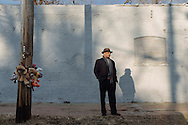 James Clark, vice president of the community outreach organization Better Family Life, stands near a memorial for a homicide victim at Arlington and Ridge Avenues in St. Louis, Missouri. There were 159 homicides in the city in 2014, a 30-percent increase over the previous year.