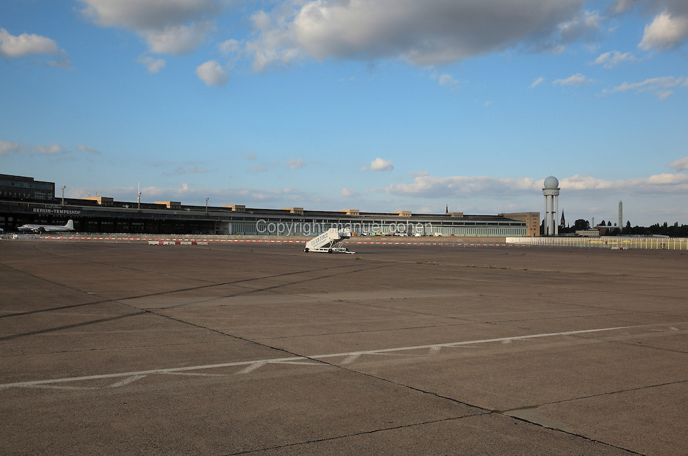 Old buildings and aeroplane taxiing area in the old Berlin Tempelhof Airport, which was closed to air traffic in 2008 and now holds events and festivals and is a gated public park, Berlin, Germany. Picture by Manuel Cohen