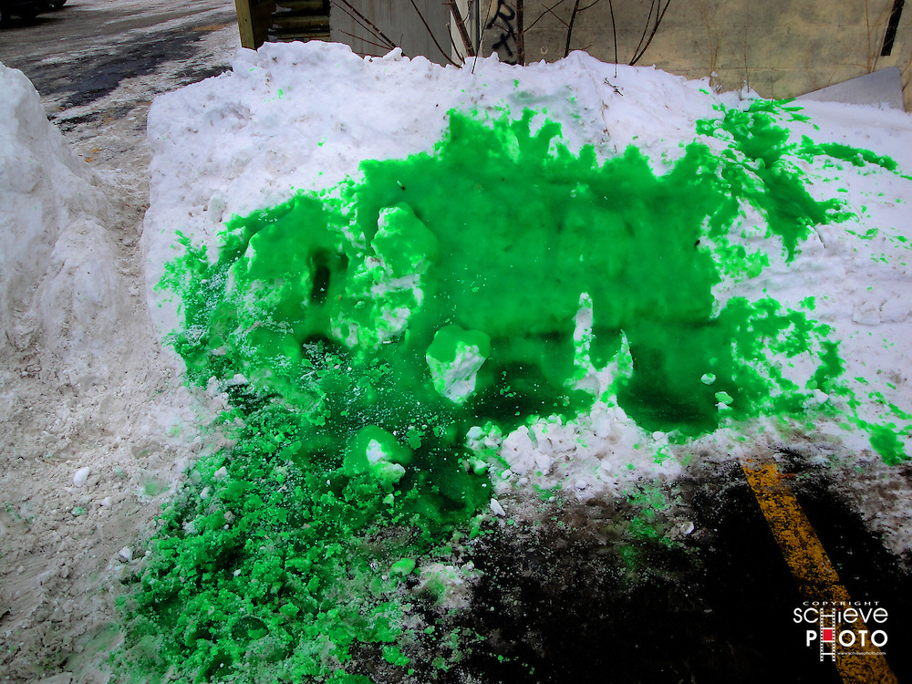 Green Bay Packers green blood on a snow bank.