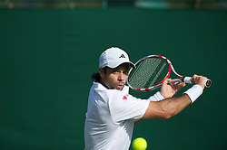 LONDON, ENGLAND - Tuesday, June 21, 2011: Fernando Gonzalez (CHI) in action during the Gentlemen's Singles 1st Round match on day two of the Wimbledon Lawn Tennis Championships at the All England Lawn Tennis and Croquet Club. (Pic by David Rawcliffe/Propaganda)