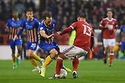 Shrewsbury Town midfielder Alex Rodman (23) clashes with Nottingham Forest defender Danny Fox (13) during the EFL Cup match between Nottingham Forest and Shrewsbury Town at the City Ground, Nottingham, England on 8 August 2017. Photo by Jon Hobley.