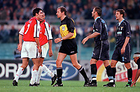 Robert Pires (Arsenal) clashes with Lazio defender Sinisa Mihajlovic as referee Hellmut Krug steps in. S.S.Lazio 1:1 Arsenal, UEFA Champions League, Group B, Olympic Stadium, Rome, 17/10/2000. Credit Colorsport / Stuart MacFarlane.