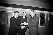 16/12/1965<br /> 12/16/1965<br /> 16 December 1965<br /> <br /> Apprentice of the Year Award at Building Centre in Dublin<br /> <br /> Picture shows Mr. George Colley T.D.(right) Minister for Education presenting the gold medal to James Phelan with Mr. John G Sisk Managing director of John Sisk&Son Ltd.
