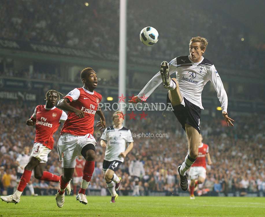 LONDON, ENGLAND - Wednesday, April 20, 2011: Tottenham Hotspur's Peter Crouch and Arsenal's Johan Djourou during the Premiership match at White Hart Lane. (Photo by David Rawcliffe/Propaganda)