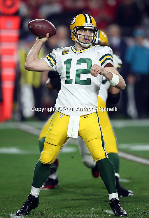 Green Bay Packers quarterback Aaron Rodgers (12) throws a pass during the NFL NFC Divisional round playoff football game against the Arizona Cardinals on Saturday, Jan. 16, 2016 in Glendale, Ariz. The Cardinals won the game in overtime 26-20. (©Paul Anthony Spinelli)