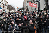 Ukraine, Donetsk: Pro-Russia demonstrators stand in a street not far from the Security Service building in Donetsk and shout pro-Russian slogans at Ukrainian riot police on March 16, 2014. Pro-Russia demonstrators in the eastern city of Donetsk called Sunday for a referendum similar to the one in Crimea as some of them stormed the prosecutor-general's office. ALESSIO ROMENZI