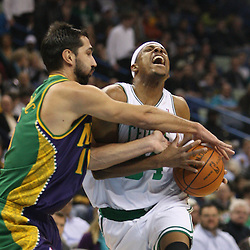Feb 10, 2010; New Orleans, LA, USA; New Orleans Hornets forward Peja Stojakovic (16) fouls Boston Celtics forward Paul Pierce (34) as he drives to the basket during the first quarter at the New Orleans Arena. Mandatory Credit: Derick E. Hingle-US PRESSWIRE