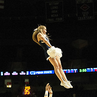 A Penn State cheerleader performs during a break in the action during the second half of an NCAA basketball game in Unversity Park, Pa., Wedneday, February 27, 2013.