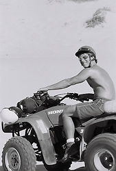 Man riding an ATV in the sand