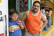 (MODEL RELEASED IMAGE). Emmanuel Casales with his father, Marco Antonio. (Supporting image from the project Hungry Planet: What the World Eats.) The Casales family of Cuernavaca, Mexico, is one of the thirty families featured, with a weeks' worth of food, in the book Hungry Planet: What the World Eats.