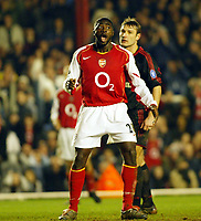 Photo. Chris Ratcliffe, Digitalsport<br /> Arsenal v Bayern Munich. Champions League. 09/03/2005<br /> Kolo Toure can't believe he missed this header in the dying minutes.