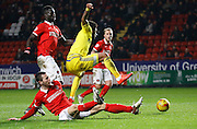 Charlton Athletic defender Harry Lennon gets in a vital tackle against Nottingham Forest forward Ryan Mendes during the Sky Bet Championship match between Charlton Athletic and Nottingham Forest at The Valley, London, England on 2 January 2016. Photo by Andy Walter.