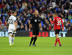 Swansea City's Angel Rangel and Cardiff City's Craig Bellamy are spoken to by Referee, Mike Dean - Photo mandatory by-line: Joe Meredith/JMP - Tel: Mobile: 07966 386802 03/11/2013 - SPORT - FOOTBALL - The Cardiff City Stadium - Cardiff - Cardiff City v Swansea City - Barclays Premier League