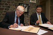 President Destler and Dr. Shou Chen, Vice President of Hunan University, sign an agreement to open a joint school of design in Shenzen, China on Saturday, October 25, 2014.