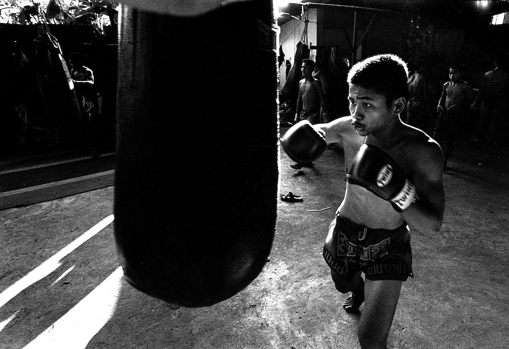 Fighters train at the Muay Thai Boxing Club under the freeway at Khlong Toei, Bangkok Thailand March 2003 .©David Dare Parker/AsiaWorks Photography
