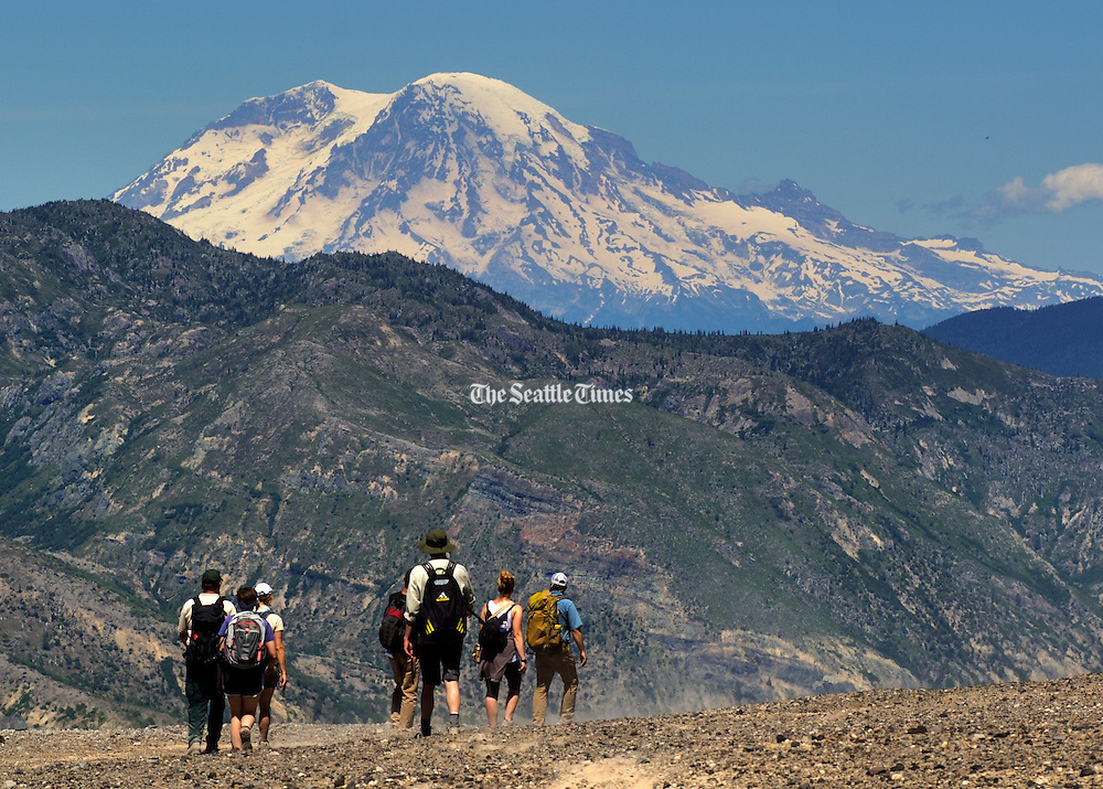 Hiking the trails at Mount St. Helens offers views of other Cascade volcanos including Mt. Rainier.<br />