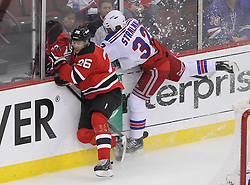 May 21, 2012; Newark, NJ, USA; New York Rangers defenseman Anton Stralman (32) hits New Jersey Devils center Patrik Elias (26) during the first period in game four of the 2012 Eastern Conference Finals at the Prudential Center.