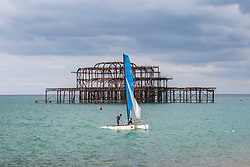 © Licensed to London News Pictures. 14/07/2019. Brighton, UK. A sailing boat returns to the beach in Brighton and Hove after the morning out on the sea. Photo credit: Hugo Michiels/LNP