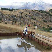 Kirsty Sharapoff riding Shoot the Breeze in action at the water jump during the Cross Country event at the Wakatipu One Day Horse Trials at the Pony Club grounds,  Queenstown, Otago, New Zealand. 15th January 2012. Photo Tim Clayton