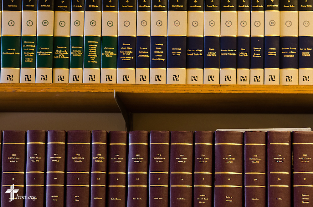 Books displayed on the wall behind Jeffrey H. Pulse, associate professor of exegetical theology at Concordia Theological Seminary, as he works at his desk on Monday, Jan. 20, 2014, in Fort Wayne, Ind.  LCMS Communications/Erik M. Lunsford