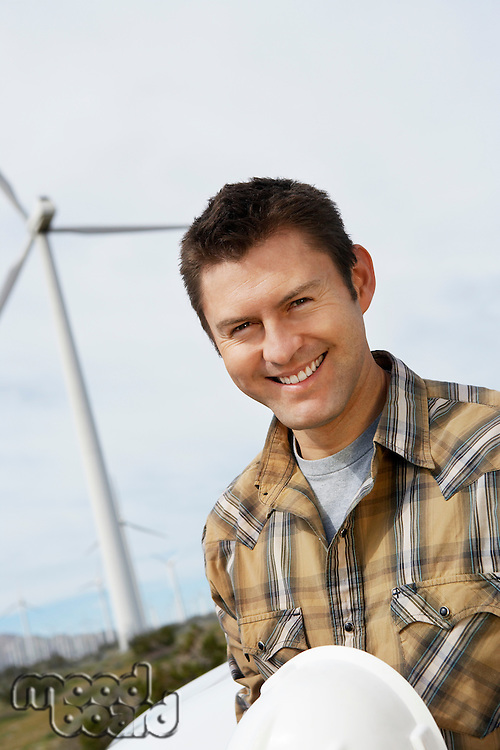 Engineer at wind farm, portrait