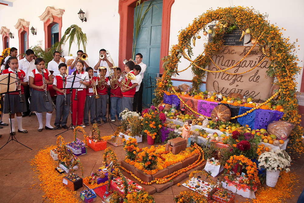 North America, Mexico, Oaxaca Province, Ocotlan,  students in school band performing by newly-constructed altar (ofrenda) during Day of the Dead (Dias de los Muertos) celebration